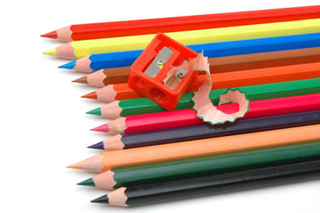 Sharpened coloured pencils and the pencil sharpener  Stock Photo - 7168683