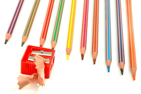 Sharpened coloured pencils , sharpener and  swarf of wood photo