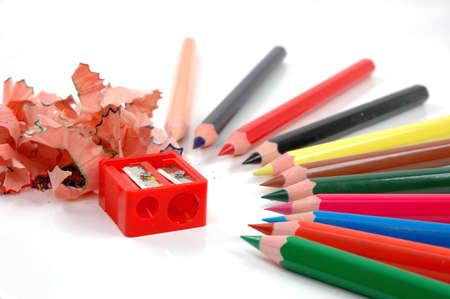 Coloured pencils ,sharpener and swarf of sharpenerd wood Stock Photo - 7168677