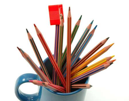 Coloured pencils and sharpener in mug photo