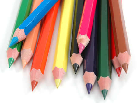 Thick coloured pencils on white background photo