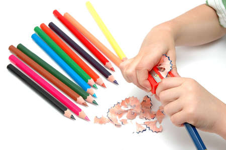 sharpen: Child with sharpener , sharpen the  colour pencils Stock Photo