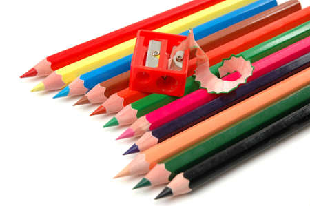 sharpened coloured pencils and the pencil sharpener Stock Photo - 7540146
