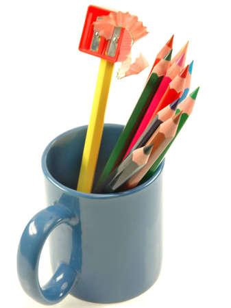 Pencils and pencil sharpener in mug Stock Photo - 7540119
