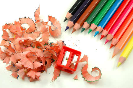 Sharpened coloured pencils, swarf of wood and sharpener Stock Photo - 7540149