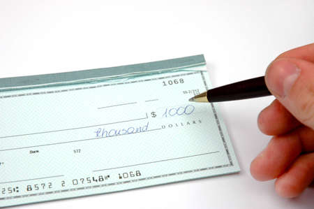 Writing a  blank check Stock Photo - 7613882