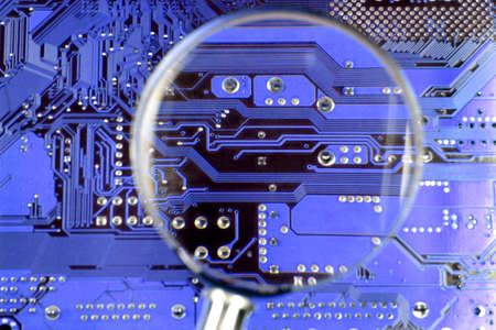Circuit board closeup by magnifying glass Stock Photo - 7918359