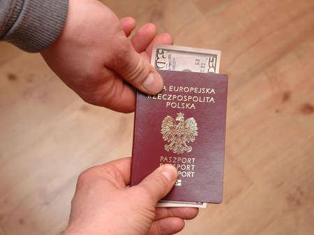 Passport with dollars inside -bribe photo