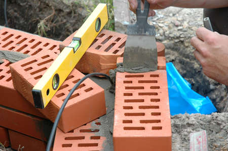 Wall under bricklaying with brick and cement Stock Photo - 7984956