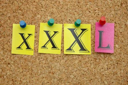 XXXL pinned on noticeboard Stock Photo - 8644182