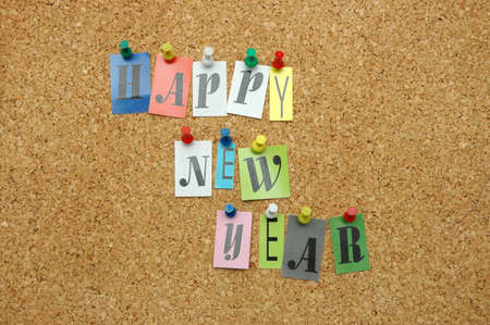 Happy new year pinned on noticeboard Stock Photo - 8645453
