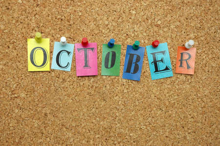 pinned: October,  month pinned on noticeboard Stock Photo