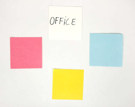 duties: Blank color papers on board for office inscriptions like reminding or duties  Stock Photo