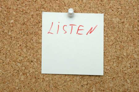 Listen- pinned on notice board Stock Photo - 9319192