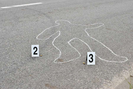 chalk outline: Chalk outline of human body on the street Stock Photo