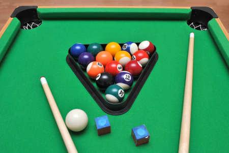 cue sticks: Billiard table with set of billiard balls , chalks and Cue sticks