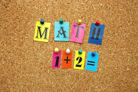 noticeboard: Mathematical symbols pinned on noticeboard