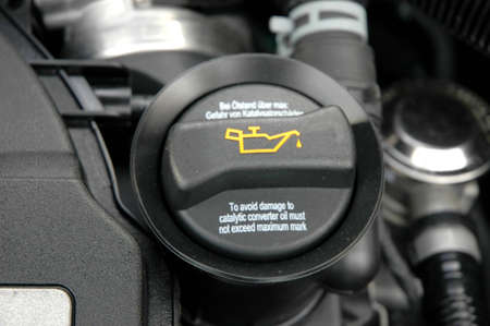 antifreeze: Screw cap of oil close-up