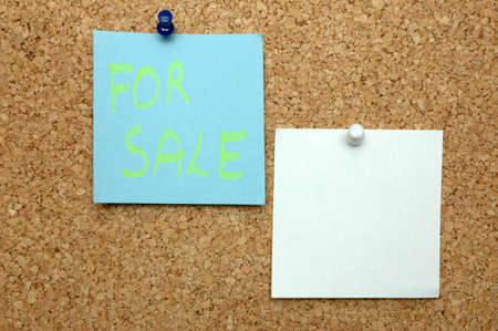 Announcing the sale on bulletin board photo