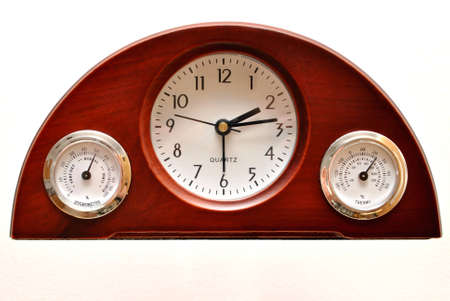 humidity gauge: Clock with temperature and humidity Stock Photo