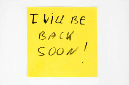 I willbe back soon on yellow paper Stock Photo - 10513052