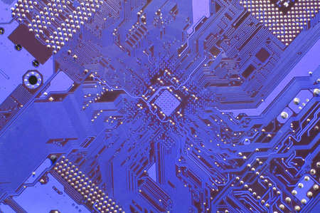 A close up of a blue computer circuit.  photo