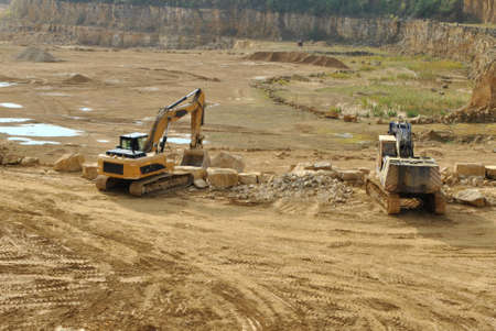 Diggers in the quarry photo