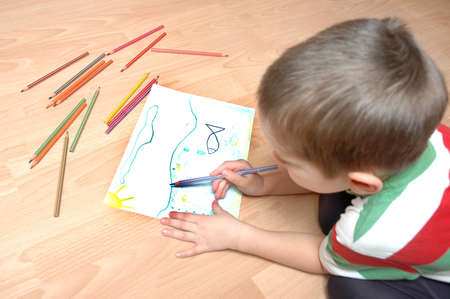 child  paint picture with crayons photo