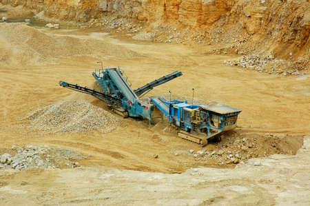 Machine in quarry- open-pit mine photo