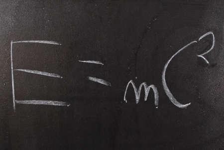 equivalence: Physics formula written on the blackboard