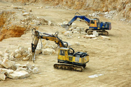 Rock Crusher and digger in quarry  photo