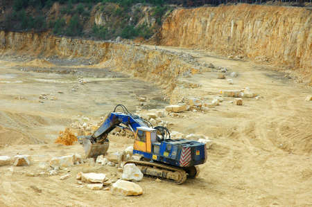 Digger in quarry- open-pit mine photo