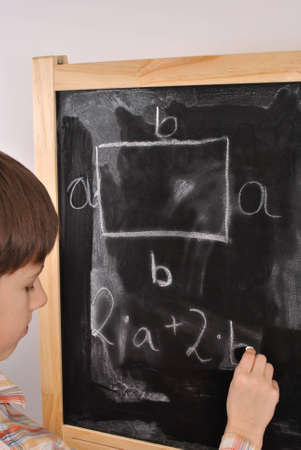The perimeter of the rectangle - student by the blackboard Stock Photo - 15870800