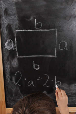 The perimeter of the rectangle - student by the blackboard Stock Photo - 15978685