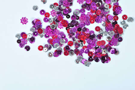 sequins: Multi colored sequins on white background Stock Photo