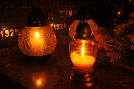 all souls' day: memory against the deceaseds- candles on the graves