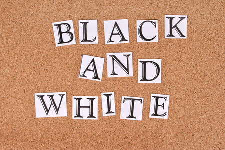 annoucement: Black and White -text on cork-board