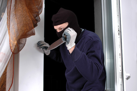 organized crime: Murderer in the balaclava with the knife in the hand