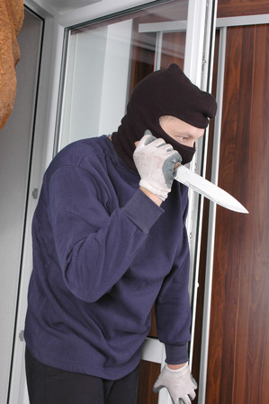 murderer: Murderer in the balaclava with the knife in the hand