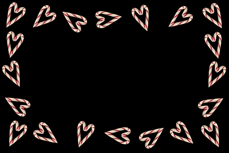 Candy cane heart frame on black background
