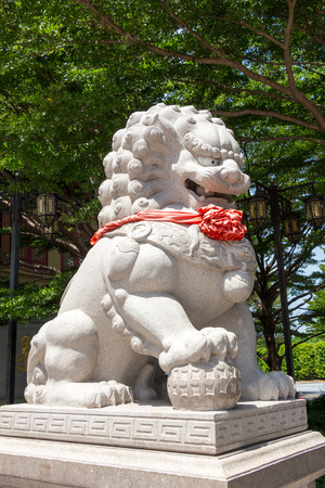stone lion: Stone lion statue in Chinese temple Stock Photo