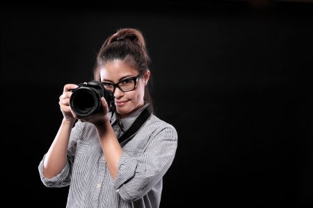 Glasses Girl with Camera Stock Photo - 19062785