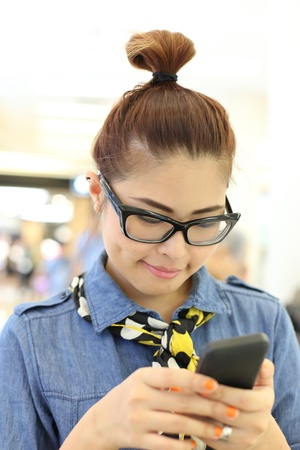 Asian Girl Reading Message from her Mobile photo