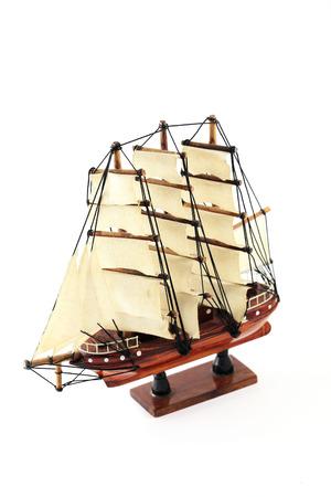 Mini Vintage Boat Toy on White Background photo