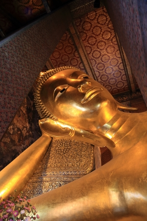 Giant Golden Buddha Statue in Wat Pho photo