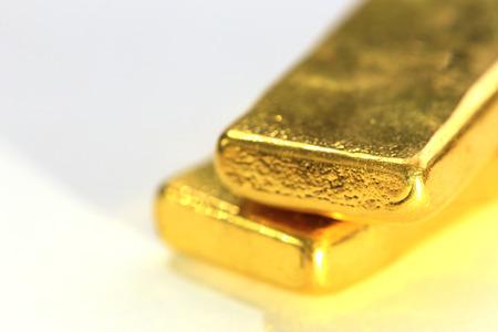 gold bullion: Shiny Gold Bar on White Background Stock Photo