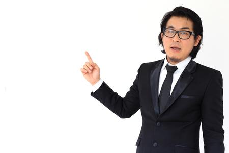explained: The Asian businessman explained presentation. Stock Photo