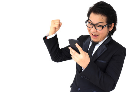 Preview Save to a lightbox  Find Similar Images  Share Stock Photo: The Asian businessman receive good news.