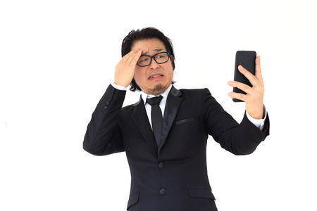 scolded: The Asian Businessman was Scolded from his Smartphone