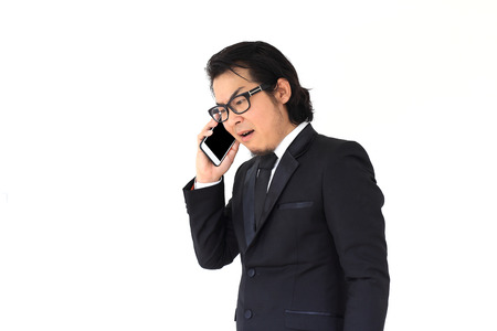 scolded: The Asian businessman angry at his smartphone Stock Photo